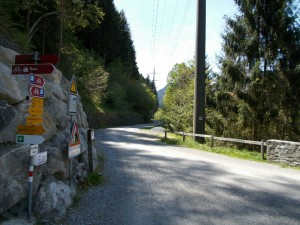 Westward shot of the gravel pathway outside of Rueun, Switzerland. Signposting in the foreground.