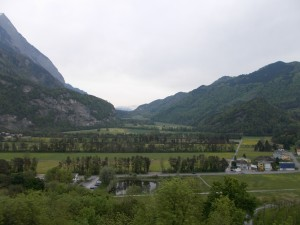 A wide angle shot of a treed valley with sparse houses in the foreground. Photo take from the top of the large hill that Schloss Gutenberg is on.