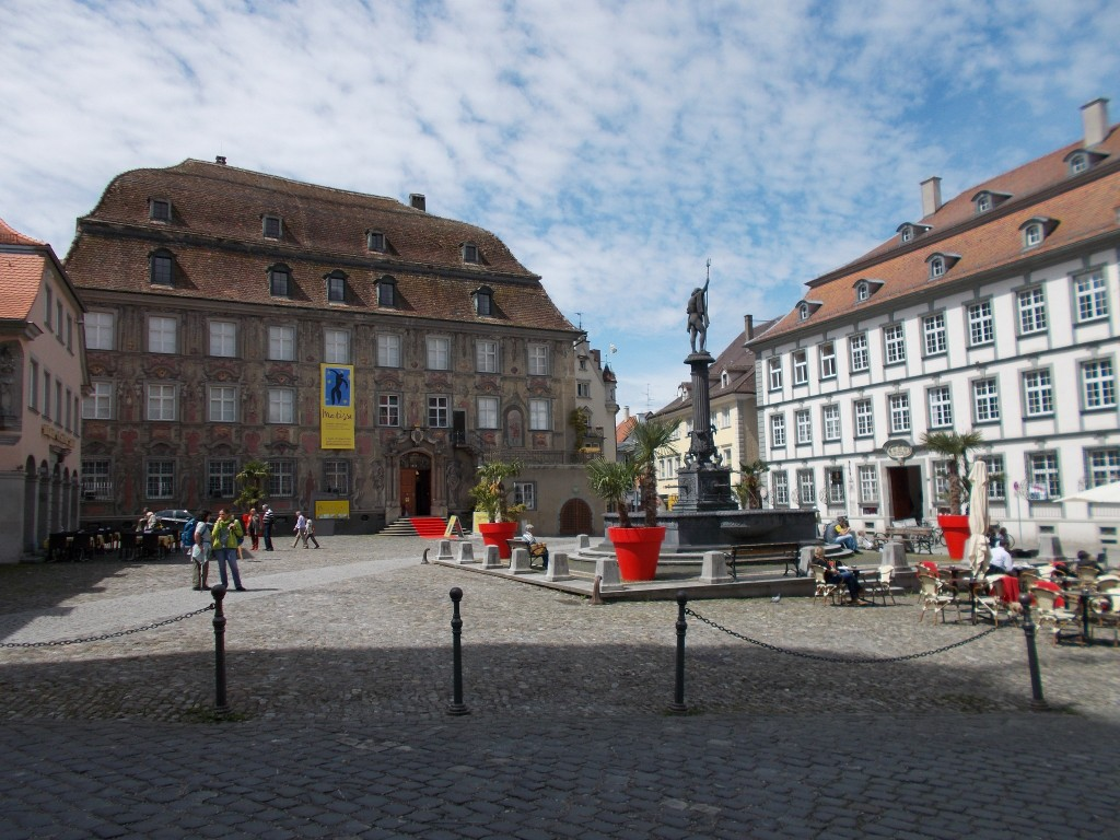 A town square with a fountain at its centre.