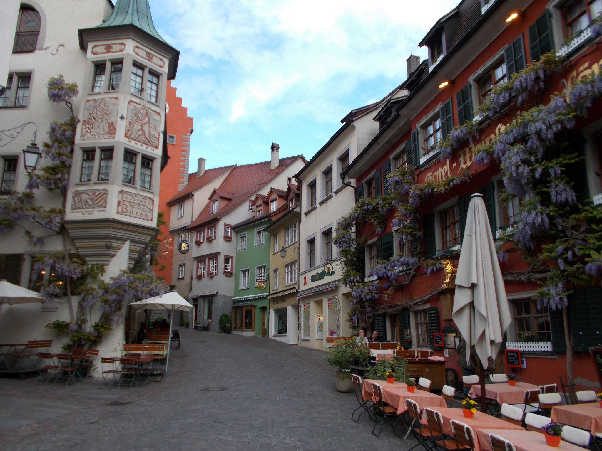 Colorful buildings lining a quiet pedestrian street in Meersburg, Germany.