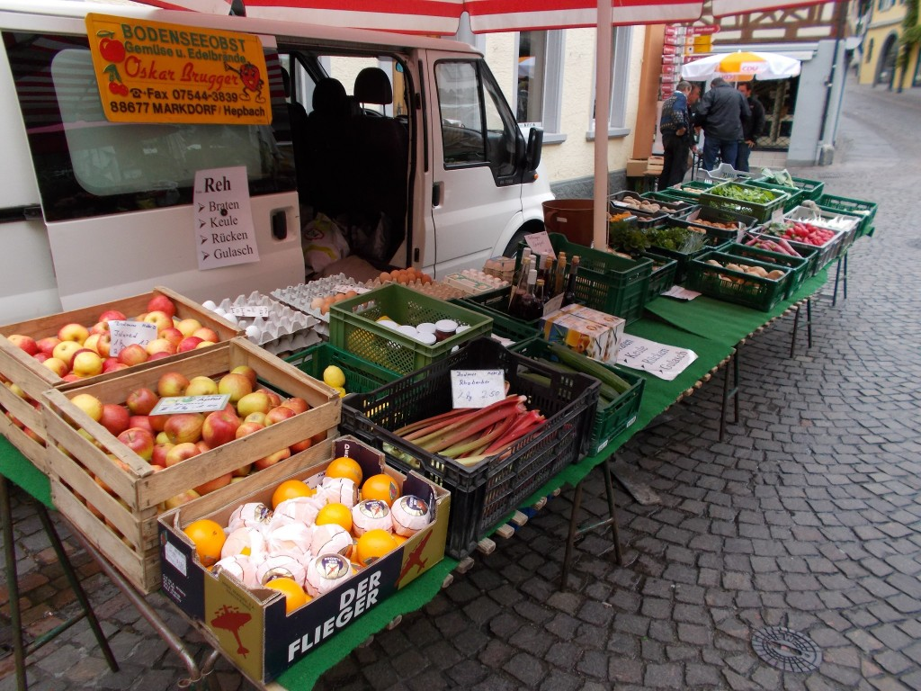 A van with a wide array of fruit, eggs, and vegetables laid out for market in Meersburg, Germany.