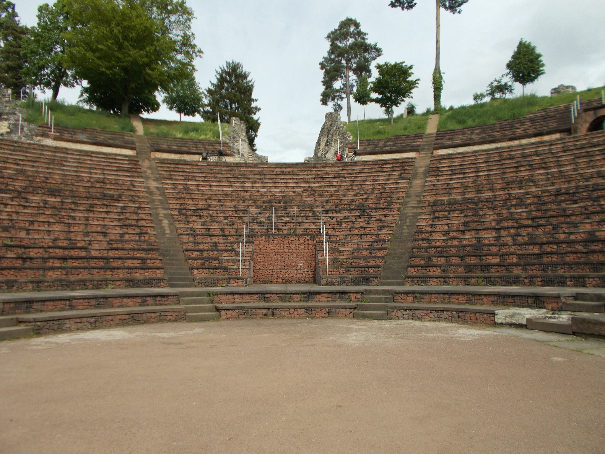 A brickwork Roman amphitheatre photographed from inside the amphitheatre floor.