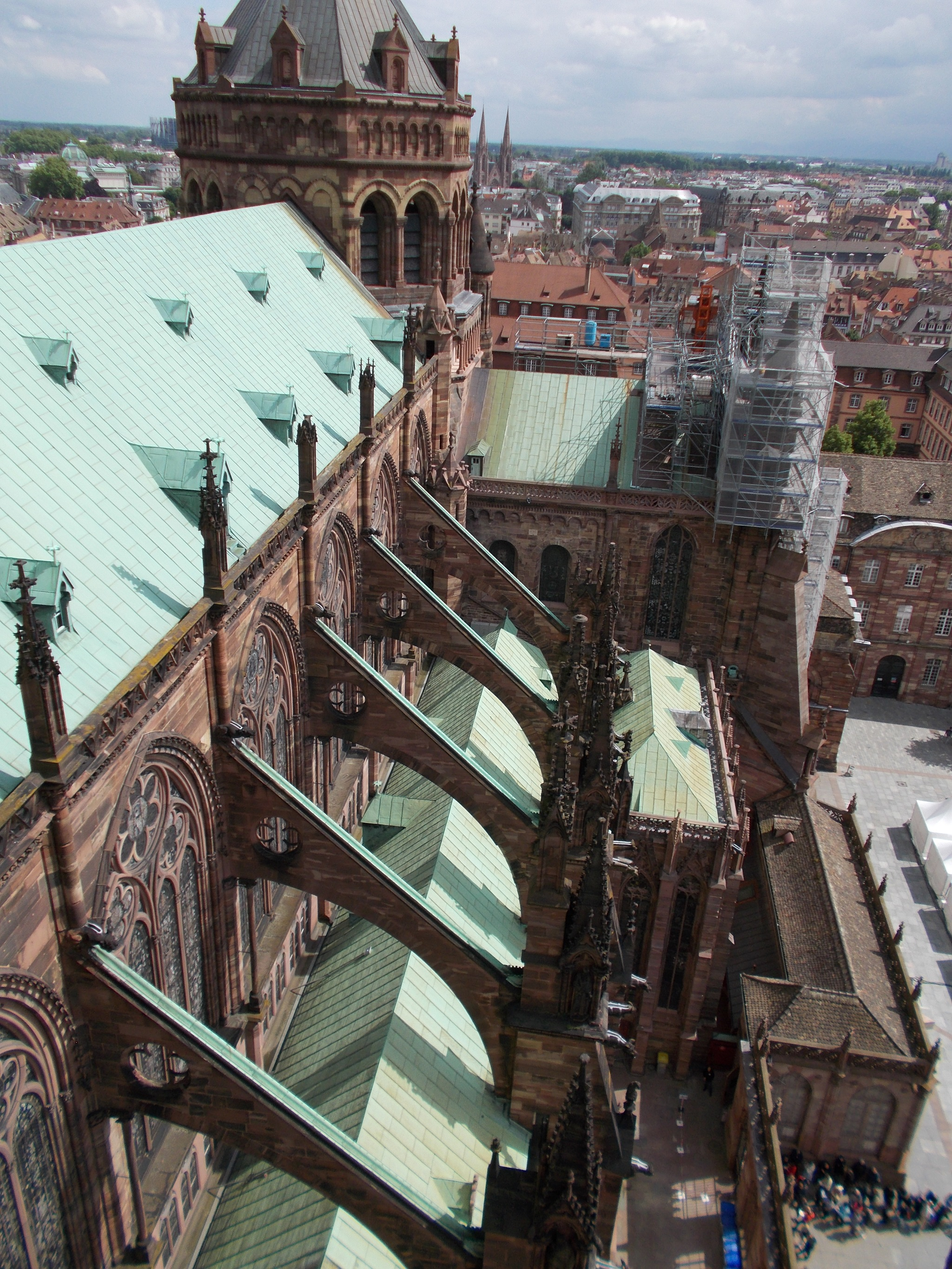 A snapshot of large flying buttresses on a large cathedral.